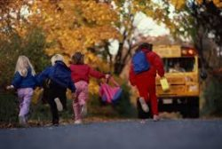 Kids running to school bus