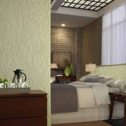 Bedroom with Fasade wall panels Nettle in Fern color are an alternative to wall murals