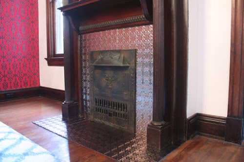 Fireplace gets new life with Fasade Tiles