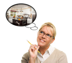woman thinking of new kitchen