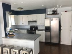 budget kitchen with metal backsplash